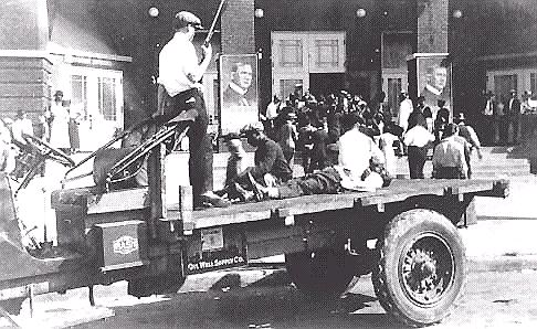 Armed white rioters with dead African American, Tulsa, 1921.